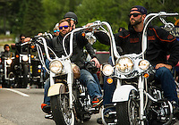 A steady flow of bike traffic rides through Weirs Beach on Sunday afternoon as Laconia's 93rd Motorcycle Week gets under way.   (Karen Bobotas/for the Laconia Daily Sun)