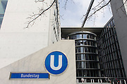 The entrance to the U-Bahn station for one of the German government Bundestag buildings known as the Paul-Loeb-Haus in Berlin Mitte. Named after the last democratic President of the Reichstag, Paul Löbe House was occupied in July 2001. It houses 550 offices for MPs, 19 conference rooms, around 450 offices for parliamentary committees, the Bundestag information service for visitors, and a restaurant that is open to the public. A pedestrian subway connects Paul Löbe House with the Reichstag building. The eastern end of the ribbon of federal buildings extends across the River Spree in the form of a parliamentary office block divided into two parts.