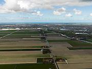 Nederland, Noord-Holland, Gemeente Schermer, 16-04-2012; Polder De Schermer, gezien langs de Lange en Kort Molenweg in de richting van Alkmaar, rechts Heerhugowaard, met ringvaart. Noordzee aan de horizon..Polder De Schermer (NW Netherlands) shows urbanisation at the expense of the agriculture. North Sea  on the horizon...luchtfoto (toeslag), aerial photo (additional fee required);.copyright foto/photo Siebe Swart