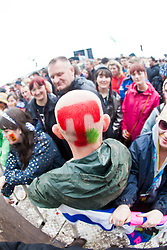 Fan with T shaved into his hair, as Elbow play the main stage. Sunday at T in the Park 2012, held at Balado, in Fife, Scotland..