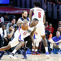 23 December 2016: LA Clippers guard Jamal Crawford (11) drives past Dallas Mavericks guard Deron Williams (8) on a screen set by LA Clippers center DeAndre Jordan (6) during the Dallas Mavericks 90-88 victory over the LA Clippers, at the Staples Center, Los Angeles, California, USA.