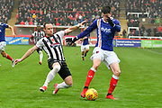 Liam McAlinden (19) of Exeter City is challenged by Ben Davies (2) of Grimsby Town during the EFL Sky Bet League 2 match between Exeter City and Grimsby Town FC at St James' Park, Exeter, England on 11 November 2017. Photo by Graham Hunt.