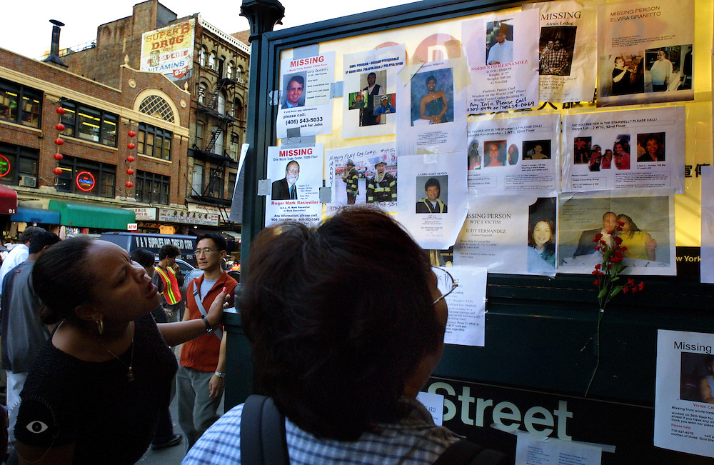 Women stop along Canal Street to view the many missing notices posted for those still unaccounted for following the World Trade Center attacks