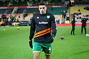 Norwich City midfielder Ben Godfrey (4) warming up before the The FA Cup 3rd round match between Norwich City and Portsmouth at Carrow Road, Norwich, England on 5 January 2019.