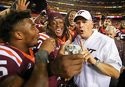Sep 3, 2017; Landover, MD, USA; Virginia Tech Hokies head coach Justin Fuente takes a selfie with Virginia Tech Hokies safety Terrell Edmunds (22) after beating the West Virginia Mountaineers at FedEx Field. Mandatory Credit: Ben Queen-USA TODAY Sports