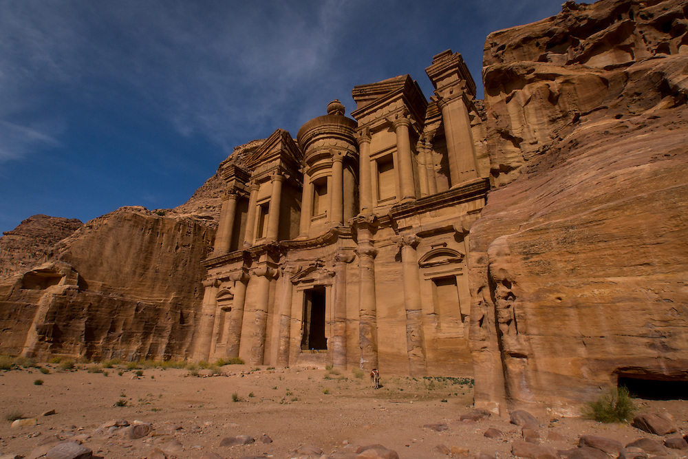 "Ad Deir which is also known as El Deir or ""The Monastery"" is a building carved out of rock in the ancient Jordan city of Petra.  It was built by the Nabataeans in the 1st century."