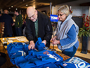 29 JANUARY 2020 - KNOXVILLE, IOWA: People look at Tom Steyer tee shirts at a campaign event in Knoxville, about 40 miles southeast of Des Moines, Wednesday. About 60 people attended the campaign meet and greet. Steyer, a California businessman, is campaigning to be the Democratic nominee for the US Presidency in 2020. Iowa holds the first selection event of the 2020 election cycle. The Iowa Caucuses are Feb. 3, 2020.         PHOTO BY JACK KURTZ