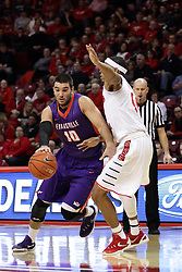 15 January 2016: Mislav Brzoja(10) works his way past DeVaughn Akoon-Purcell(44) during the Illinois State Redbirds v Evansville Purple Aces at Redbird Arena in Normal Illinois (Photo by Alan Look)