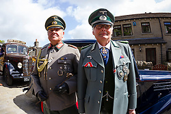 © Paul Thompson licensed to London News Pictures. 16/05/2015. Haworth, West Yorkshire, UK. Two men dressed in German Army uniforms at Haworth 1940s weekend, an annual event in which people dress in period costume and visit the village of Haworth to relive the 1940s. After complaints in previous years, the organisers have requested that people don't wear German Uniforms. Photo credit : Paul Thompson/LNP