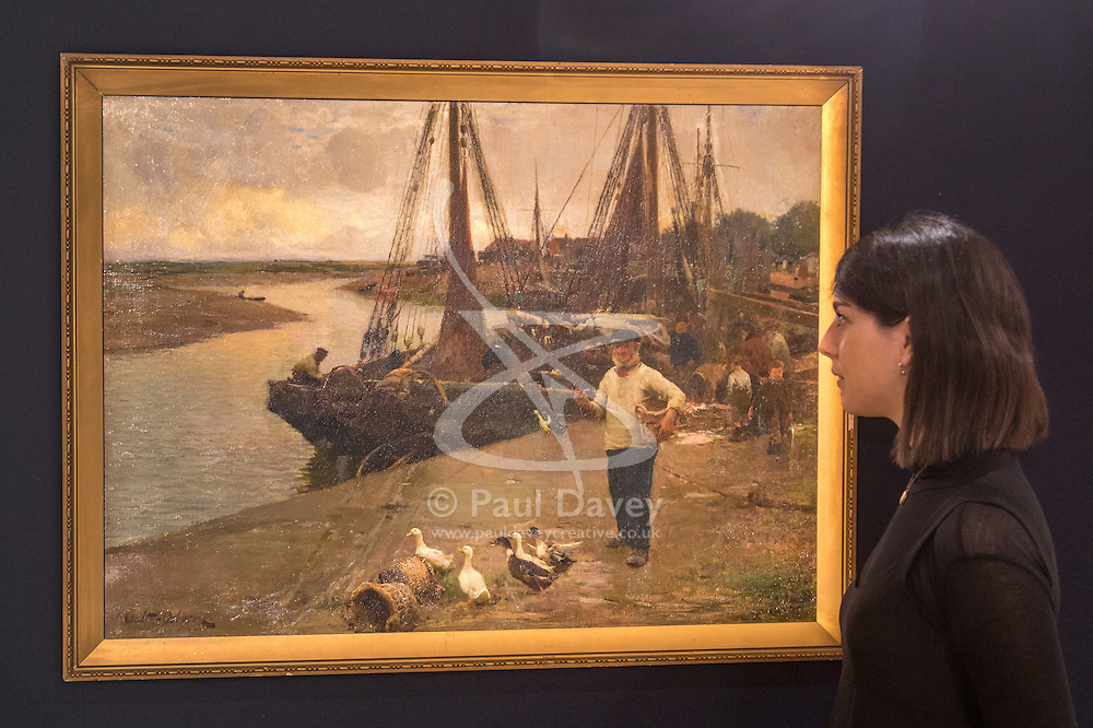 Bonhams, London, February 22nd 2017. Bonhams in London hold a press preview ahead of their 19th century paintings sale, featuring numerous valuable works including:<br /> • 'Children by the shore' by Dorothea Sharp, valued at £60,000-80,000<br /> • Barcas y pescaadores, Playa de Valencia by Joaquin Sorolla £60,000-80,000<br /> • When the Boats Come In by Walter Osborne valued at £100,000-150,000<br /> • A Solicitation by Lawrence Alma-Tadema which is expected to fetch between £30,000-50,000<br /> PICTURED: A woman admires When the Boats Come In by Walter Osborne.