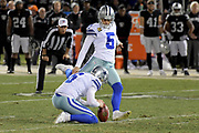 Dec 17, 2017; Oakland, CA, USA; Dallas Cowboys kicker Dan Bailey (5) kicks a field goal out of the hold of punter Chris Jones (6) against the Oakland Raiders during an NFL football game at Oakland-Alameda County Coliseum.
