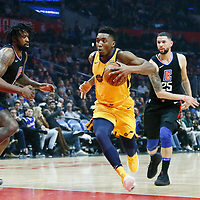 30 November 2017: Utah Jazz guard Donovan Mitchell (45) drives past LA Clippers guard Austin Rivers (25) and LA Clippers center DeAndre Jordan (6) during the Utah Jazz 126-107 victory over the LA Clippers, at the Staples Center, Los Angeles, California, USA.