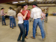29 JULY 2005 - WILLIAMS, ARIZONA, USA: Cowboys and cowgirls on the dance floor at the rodeo dance during the Arizona Cowpunchers' Reunion Rodeo, the largest amateur rodeo in Arizona, in Williams, AZ, July 29. Professional rodeo cowboys cannot participate in the rodeo. Only working ranch cowboys and their families can participate in the rodeo. Williams, a small ranching town in northern Arizona and about an hour from the south entrance to the Grand Canyon National Park, has reinvented itself as a tourist destination. The town draws tourists going to the park and tourists who want to experience American western lifestyle. The town hosts the largest amateur rodeo in Arizona drawing contestants and spectators from across the state. PHOTO BY JACK KURTZ
