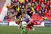 Doncaster Rovers midfielder Jordan Houghton (16), on loan from Chelsea, heads the ball away from Rotherham United forward Jonson Clarke-Harris (19)  during the EFL Sky Bet League 1 match between Doncaster Rovers and Rotherham United at the Keepmoat Stadium, Doncaster, England on 11 November 2017. Photo by Simon Davies.