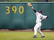 Kernels right fielder Adam Brett Walker II (38) throws the ball in during a game between the Cedar Rapids Kernels and the Quad Cities River Bandits at Veterans Memorial Stadium in Cedar Rapids, Iowa on June 5, 2013.