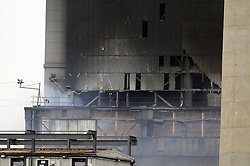 © Licensed to London News Pictures. 27/02/2012.Tilbury Power Station Fire. Fire Damage..A huge blaze has broken out at a power station in Essex, in areas containing about 4,000 tonnes of wood pellets.The  blaze at Tilbury Power Station in the Thames estuary began just before 08:00 today (27.02.2012) and quickly engulfed the building in smoke..Photo credit : Grant Falvey/LNP