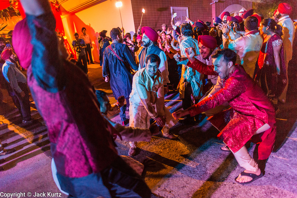 09 JANUARY 2014 - BANGKOK, THAILAND:  A Sikh wedding procession on Ekkamai Soi 6 in Bangkok. Bangkok has a vibrant and growing Sikh community and Sikhs are very active in the Thai business community.       PHOTO BY JACK KURTZ