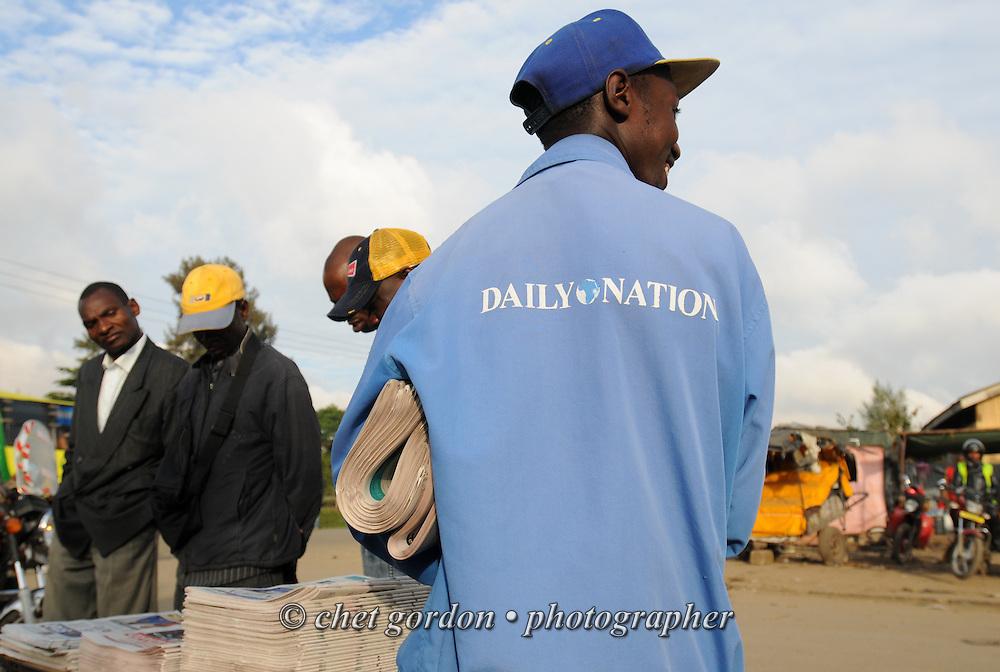 A newspaper vendor sells morning editions of Kenya's daily newspapers in the Fedha Junction neighborhood of Nairobi, Kenya on Wednesday, December 7, 2011.