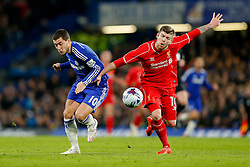 Eden Hazard of Chelsea and Alberto Moreno of Liverpool compete for the ball - Photo mandatory by-line: Rogan Thomson/JMP - 07966 386802 - 27/01/2015 - SPORT - FOOTBALL - London, England - Stamford Bridge - Chelsea v Liverpool - Capital One Cup Semi-Final Second Leg.