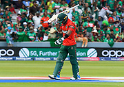 Wicket - Liton Das of Bangladesh looks dejected as he walks back to the pavilion after being dismissed by Shaheen Afridi of Pakistan during the ICC Cricket World Cup 2019 match between Pakistan and Bangladesh at Lord's Cricket Ground, St John's Wood, United Kingdom on 5 July 2019.