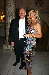 JOHN CAUDWELL founder of Phones4U and CLAIRE JOHNSON at the British Fashion Awards 2006 sponsored by Swarovski held at the V&A Museum, Cromwell Road, London SW7 on 2nd November 2006.<br />