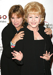 File photo dated 8/19/03 of Carrie Fisher, who has died at age 60