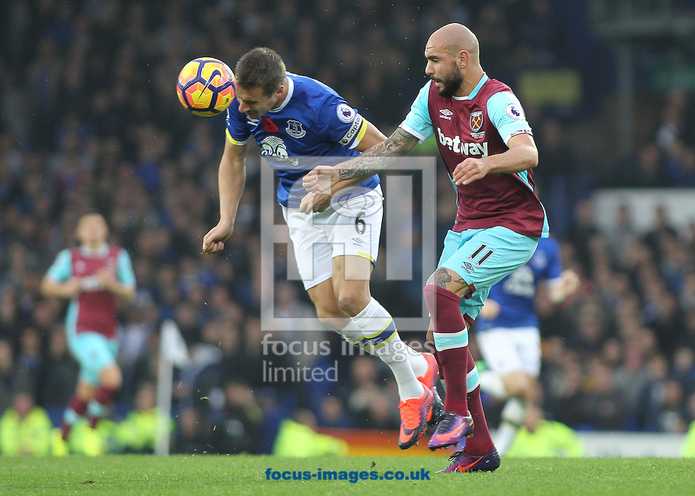 Phil Jagielka of Everton and Simone Zaza of West Ham United in action during the Premier League match at Goodison Park, Liverpool.<br /> Picture by Michael Sedgwick/Focus Images Ltd +44 7900 363072<br /> 30/10/2016