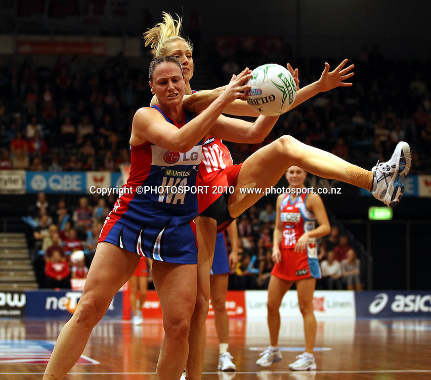 Joline Henry and Vanessa Ware contest the ball<br />