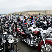 Panorama of several hundred bikes parked in the overflow staging area of the Pentagon's south parking lot before participating in the annual Rolling Thunder motorcycle rally through downtown Washington DC on May 29, 2011. This shot was taken as the riders were leaving the staging area in the Pentagon's north parking lot, where thousands of bikes and riders had gathered. The Pentagon building is in the background.