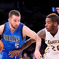 12 April 2014: Dallas Mavericks guard J.J. Barea (5) drives past Los Angeles Lakers guard Dwight Buycks (20) during the Dallas Mavericks 120-106 victory over the Los Angeles Lakers, at the Staples Center, Los Angeles, California, USA.