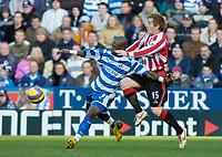 Photo: Gareth Davies.<br />Reading v Sheffield United. The Barclays Premiership. 20/01/2007.<br />Sheffield United's Rob Kozluk (R) puts his hands all over the Reading striker Leroy Lita (L).
