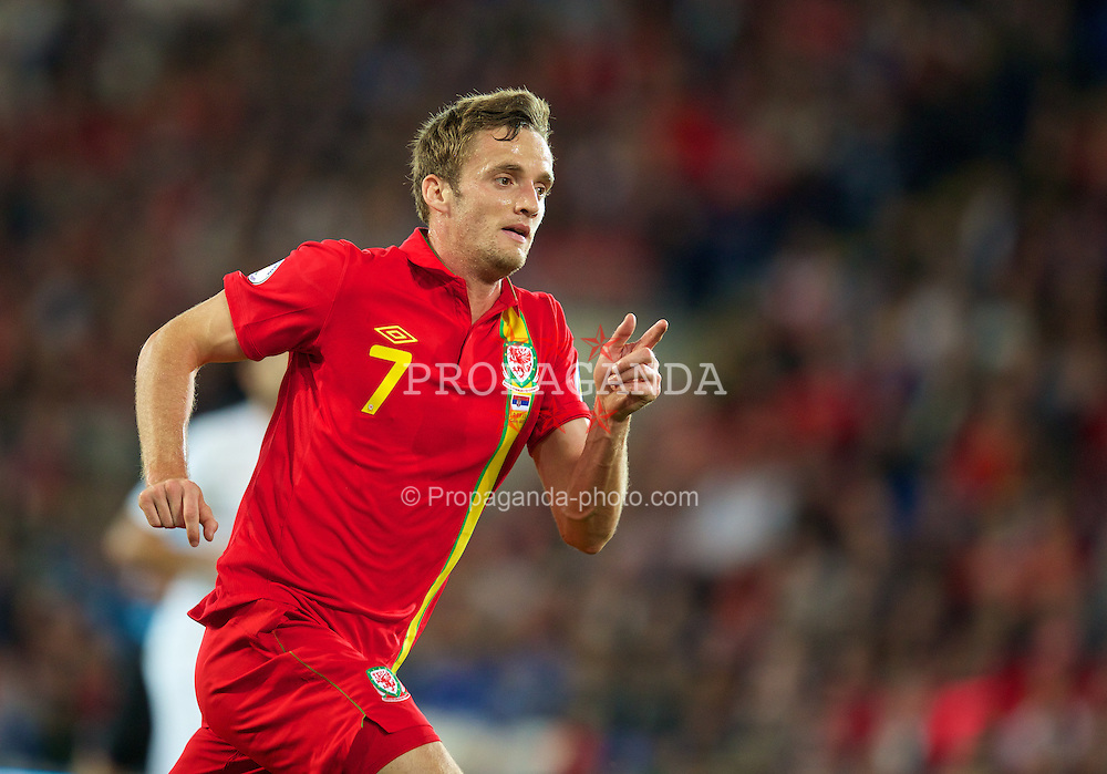 CARDIFF, WALES - Tuesday, September 10, 2013: Wales' Andy King in action against Serbia during the 2014 FIFA World Cup Brazil Qualifying Group A match at the Cardiff CIty Stadium. (Pic by David Rawcliffe/Propaganda)