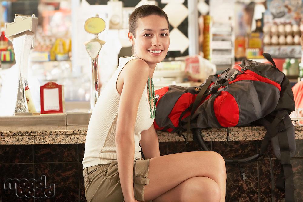Female hiker sitting in bar portrait