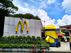 July 13, 2017 - Shenzhen, Shenzhen, China - Shenzhen, CHINA-July 12 2017: (EDITORIAL USE ONLY. CHINA OUT)..Giant adorable Yellow Minions can be seen in front of a McDonald's store in south China's Shenzhen, July 12th, 2017. (Credit Image: © SIPA Asia via ZUMA Wire)