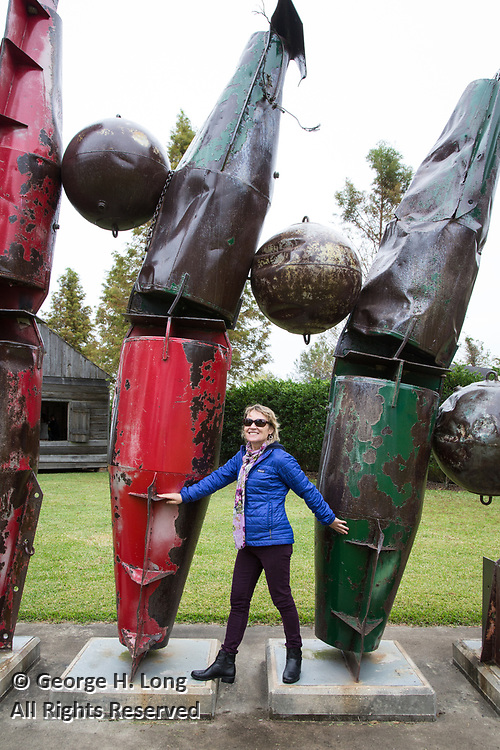 Jennifer Odem with her sculpture 'Buoyancy' created in 2010 and installed at the Jimmy Club; CEO art seminar in New Orleans; November 2017