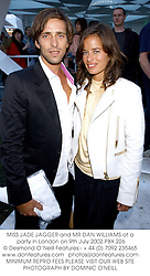 MISS JADE JAGGER and MR DAN WILLIAMS at a party in London on 9th July 2002.PBX 226