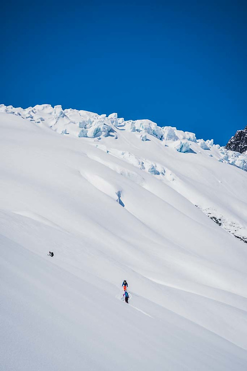 Erme Catino , Joe Morabito, and Emily Bodner out for a walk on the Loft Peak Glacier, Howson Range, British Columbia.