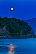 Moon rises over Chugach, Kenai Mountains, and Turnagain Arm, summer, night