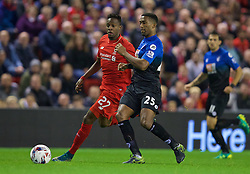 LIVERPOOL, ENGLAND - Wednesday, October 28, 2015: Liverpool's Divock Origi in action against AFC Bournemouth's Sylvain Distin during the Football League Cup 4th Round match at Anfield. (Pic by David Rawcliffe/Propaganda)