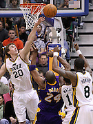 Utah Jazz guard Gordon Hayward (20) blocks a shot from Los Angeles Lakers guard Kobe Bryant (24) as Utah Jazz point guard Earl Watson (11) and forward Josh Howard (8) also defend during the second half of an NBA basketball game, Saturday, Feb. 4, 2012, in Salt Lake City. The Jazz beat the Lakers 96-87. (AP Photo/Colin E Braley).