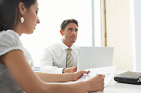 Businesswoman and Businessman in Meeting