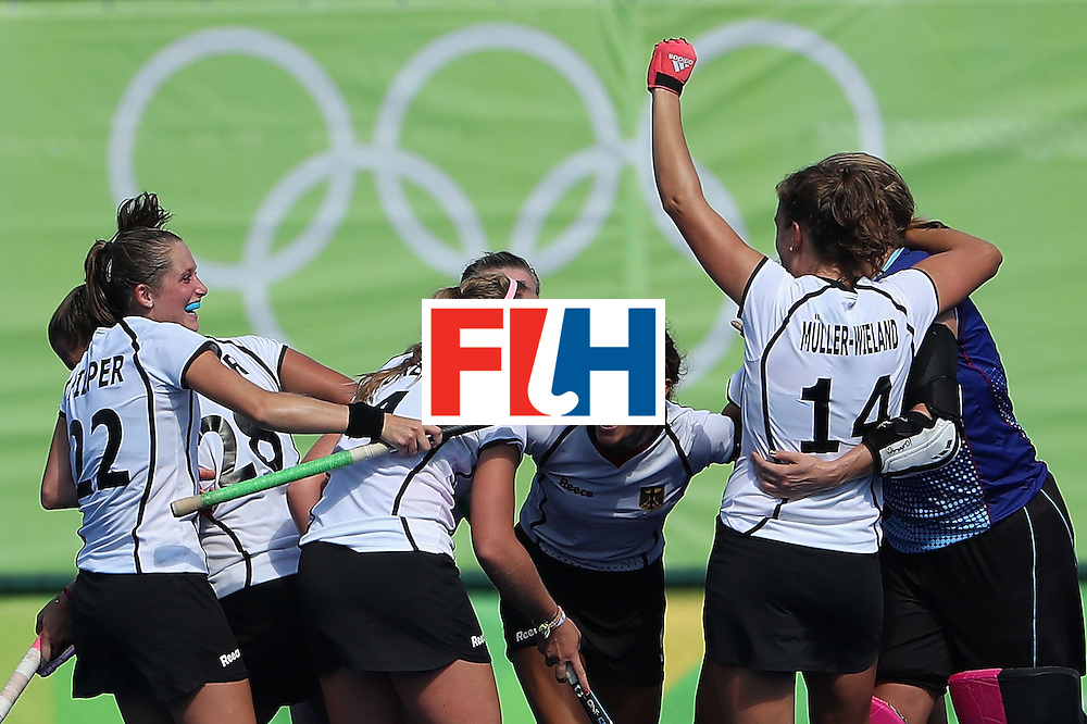 RIO DE JANEIRO, BRAZIL - AUGUST 15:  (L-R) Cecile Pieper #22, Nike Lorenz #4, Selin Oruz #5 and Janne Muller-Wieland #14 of Germany celebrate after defeating United States 2-1 in the quarter final hockey game on Day 10 of the Rio 2016 Olympic Games at the Olympic Hockey Centre on August 15, 2016 in Rio de Janeiro, Brazil.  (Photo by Christian Petersen/Getty Images)