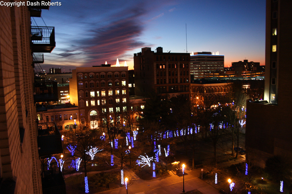 December sun sets on downtown Knoxville, Tn. over Christmas lights in Krutch Park.