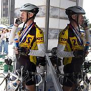 El Tour de Tucson participant makes phone call after completing the 2009 event. Bike-tography by Martha Retallick.