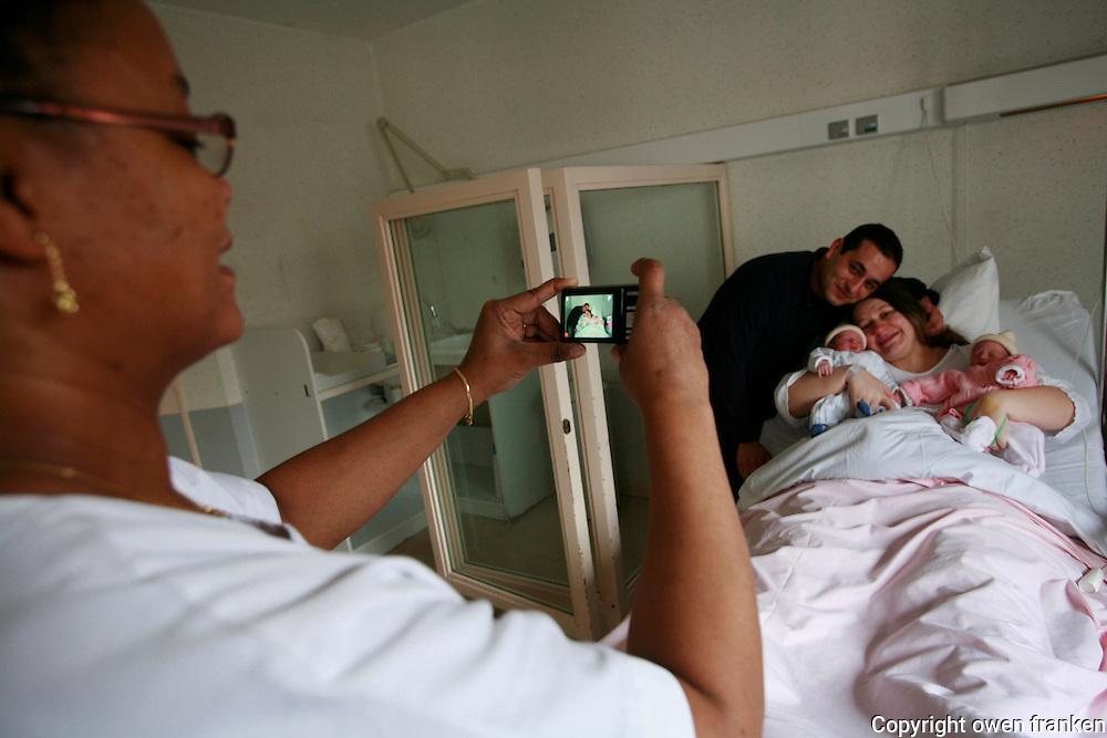 ..maternité-notre dame du grands secours, Paris -.. twins- father and his new babies, delivering to their mother..Chafik BEN AMAR and Aurelie JUIN.