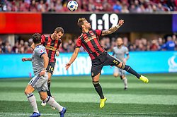 October 21, 2018 - Atlanta, GA, U.S. - ATLANTA, GA - OCTOBER 21:Atlanta United defender Leandro Gonzalez (5) heads the ball out of the goal box  during the MLS game between the Atlanta United and the Chicago Fire on October 21, 2018 at the Mercedes-Benz Stadium in Atlanta, GA. Atlanta United FC secured a place in next year's CONCACAF Champions League with a 2-1 victory against the visiting Chicago Fire. (Photo by John Adams/Icon Sportswire) (Credit Image: © John Adams/Icon SMI via ZUMA Press)