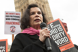 © Licensed to London News Pictures. 26/01/2015. London, UK. Activist, Bianca Jagger joins protestors in an anti-fracking rally opposite the Houses of Parliament in Westminster, London today.. Photo credit : Vickie Flores/LNP
