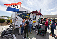 Folks lined up for a taste of the menu at the fork ING AWESOME food truck at Tanger Outlet in Tilton during the Exit 20 Food Truck Festival on Saturday.  (Karen Bobotas/for the Laconia Daily Sun)
