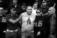 "ITALY, NAPLES :  Italian Police escort camorra mafia organisation boss Cesare Pagano (c) after his arrest in Licola on July 8, 2010.  Cesare Pagano is one of the 30 most wanted fugitives of Italy and is at the head of ""scissionisti"" clan that was responsable of more than 80 homicides in the city of Naples and its suburbs. AFP PHOTO / ROBERTO SALOMONE"