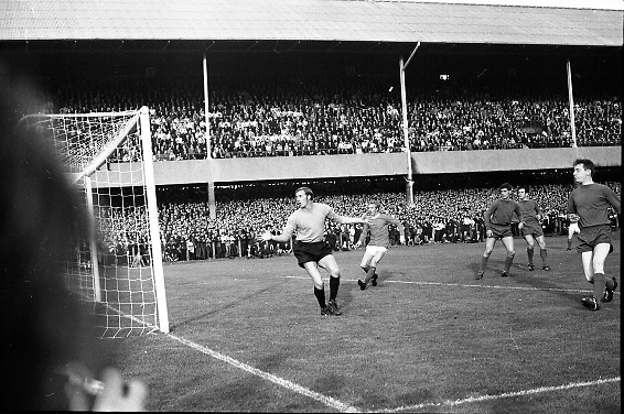 """Waterford FC vs Manchester United at Lansdowne Road..1968..18.09.1968..09.18.1968..18th September 1968..Waterford FC as champions of the league of Ireland drew Manchester United, the European Champions,in the first round of this years competition.The Waterford team was as follows: Peter Thomas, Peter Bryan, Noel Griffin, Vinny Maguire, Jackie Morley, Jimmy McGeough, Al Casey, Alfie Hale, John O'Neill, Shamie Coad and Johnny Matthews. Manchester United won the tie 3 -1 with Denis Law being the man of the match..Alex Stepney,Tony Dunne,Francis Burns,Paddy Crerand,.Bill Foulkes,Nobby Stiles,George Best,Denis Law,.Bobby Charlton,David Sadler,Brian Kidd were the starting eleven for United...""""A close shave"""" a relieved Waterford defence watch the ball pass on the outside of the post."""